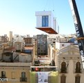 Popout prefab flats assembled and stacked on Barcelona roofs