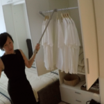 nArchitects' Mimi Hoang shows the built-in furniture in a 300-square-foot unit of Carmel Place.